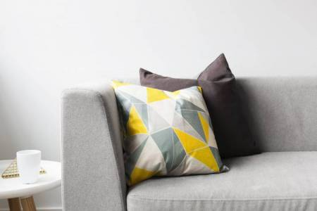 Modern grey couch and pillows